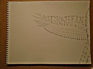 The first study, to figure if I could even spell the word Grateful with pen drawn feathers.