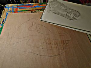 Laying out the shapes on the plywood.